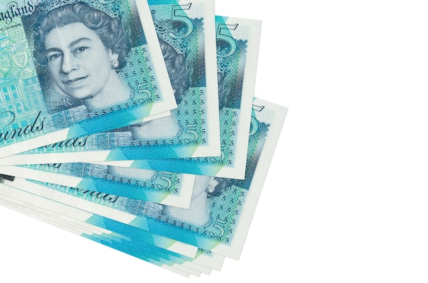 5 british pounds bills lies in small bunch or pack isolated on white.  business and currency exchange concept