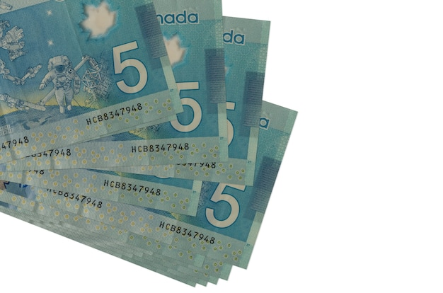 5 canadian dollars bills lies in small bunch or pack isolated on white