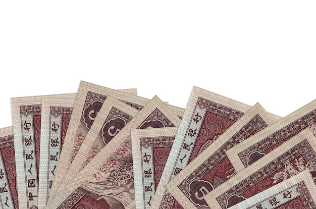 5 chinese yuan bills lies on bottom side of screen isolated on white background with copy space