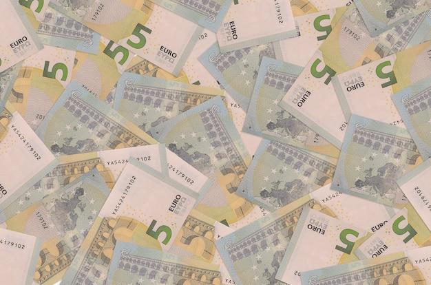 5 euro bills lies in big pile