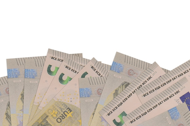 5 euro bills lies on bottom side of screen isolated on white wall with copy space. wall banner template for business concepts with money