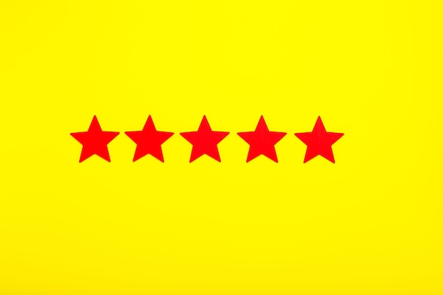 5 stars increase rating, customer experience concept. 5 red stars excellent rating on yellow background.