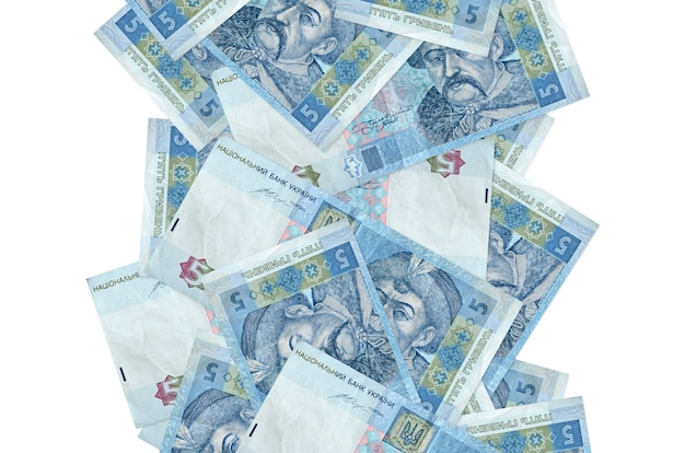 5 ukrainian hryvnias bills flying down isolated on white. many banknotes falling with white copy space on left and right side