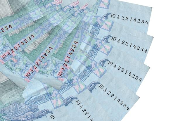 5 우크라이나어 hryvnias 지폐 팬 모양에 쌓인 복사 공간이 흰 벽에 고립 된 거짓말을 닫습니다. 금융 거래 개념