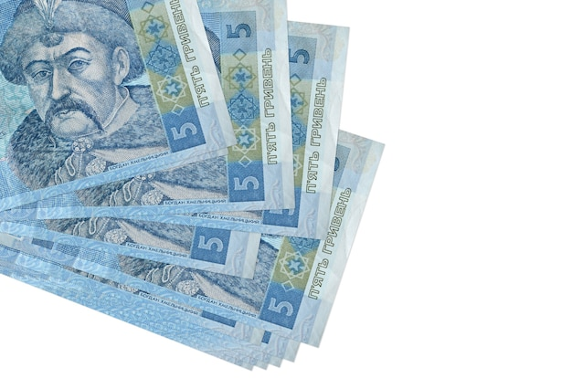 5 ukrainian hryvnias bills lies in small bunch or pack isolated on white. business and currency exchange concept
