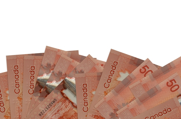 50 canadian dollars bills lies on bottom side of screen isolated on white wall with copy space.