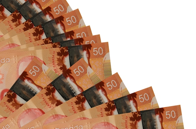 50 canadian dollars bills lies isolated on white wall with copy space stacked in fan close up. payday time concept or financial operations