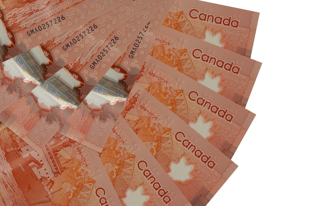 50 canadian dollars bills lies isolated on white wall with copy space stacked in fan shape close up. financial transactions concept