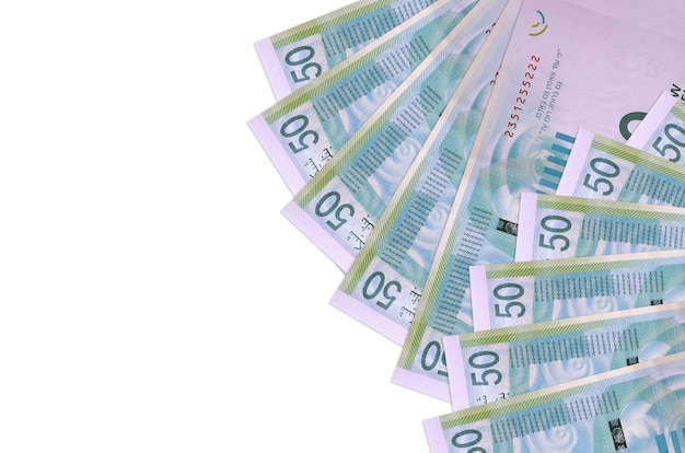50 israeli new shekels bills lies isolated on white wall with copy space. rich life conceptual wall. big amount of national currency wealth