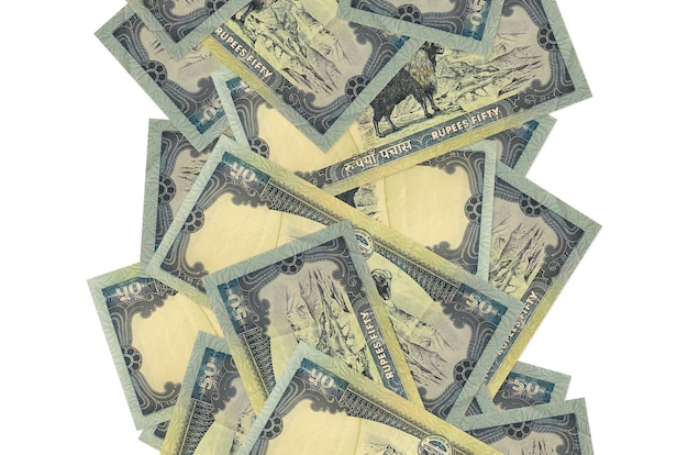 50 nepalese rupees bills flying down isolated on white. many banknotes falling with white copy space on left and right side