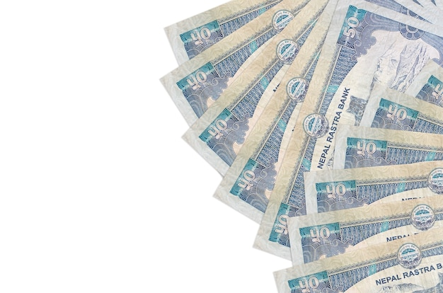 50 nepalese rupees bills lies isolated  . rich life conceptual background. big amount of national currency wealth