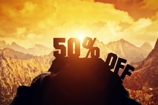 50% off writing on a mountain peak.