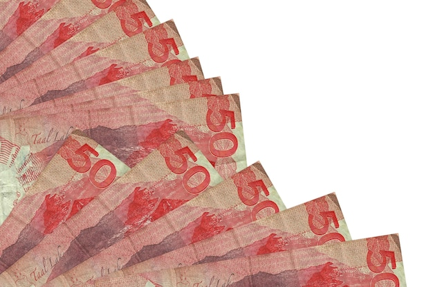 50 philippine piso bills lies isolated on white wall with copy space stacked in fan close up. payday time concept or financial operations