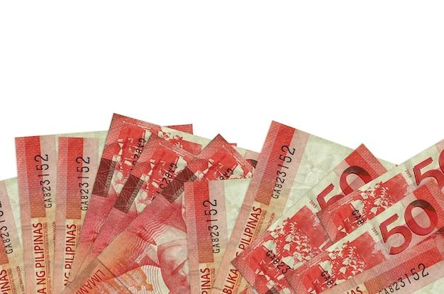 50 필리핀 piso 지폐 복사 공간이 흰 벽에 고립 된 화면의 아래쪽에 놓여 있습니다.