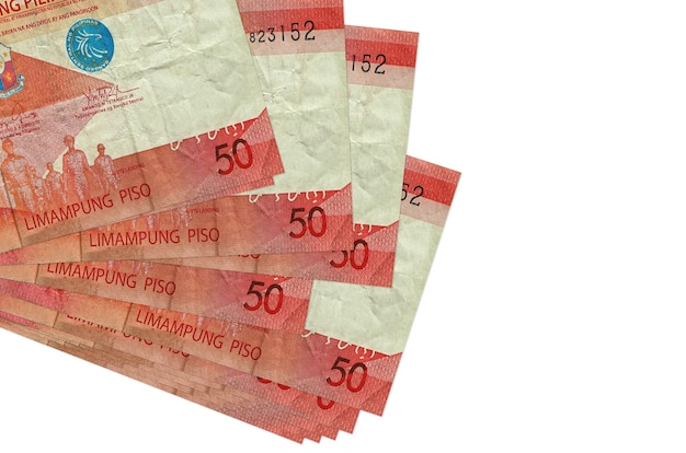 50 philippine piso bills lies in small bunch or pack isolated on white