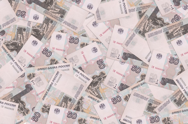 50 russian rubles bills lies in big pile. rich life conceptual background. big amount of money