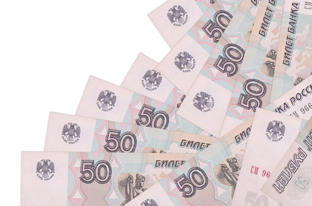 50 russian rubles bills lies in different order isolated on white. local banking or money making concept.