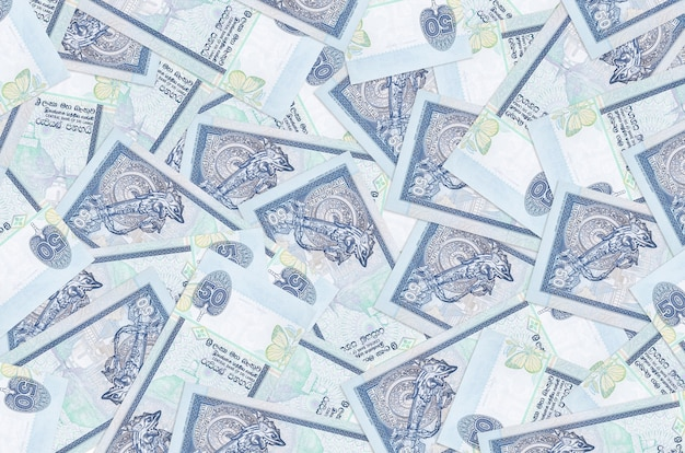 50 sri lankan rupees bills lies in big pile. rich life conceptual wall. big amount of money