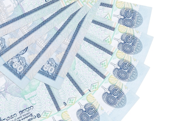 50 sri lankan rupees bills lies isolated on white background with copy space stacked in fan shape close up