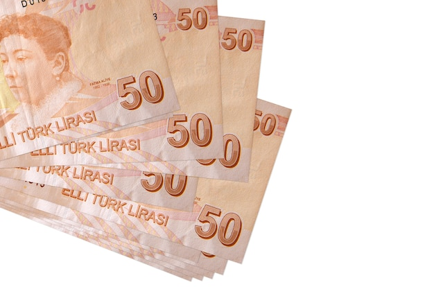 50 turkish liras bills lies in small bunch or pack isolated on white