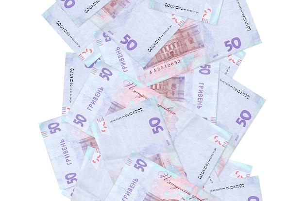 孤立して飛んでいる50のウクライナグリブナ手形。多くの紙幣が左右に白いコピースペースで落ちています