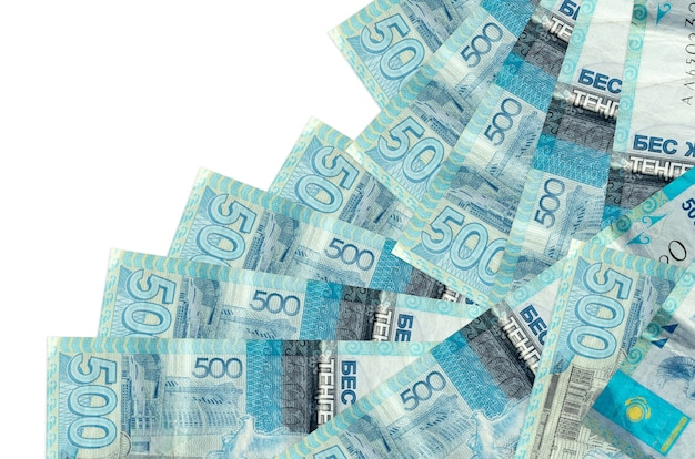 500 kazakhstani tenge bills lies in different order isolated on white