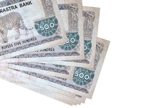 500 nepalese rupees bills lies in small bunch or pack isolated on white.  business and currency exchange concept