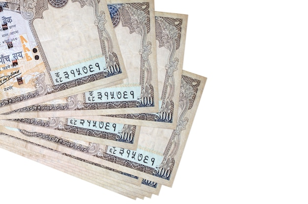 500 nepalese rupees bills lies in small bunch or pack isolated on white