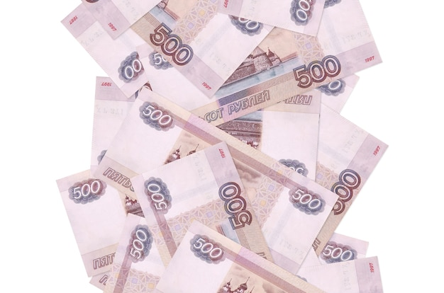 500 russian rubles bills flying down isolated on white. many banknotes falling with white copy space on left and right side