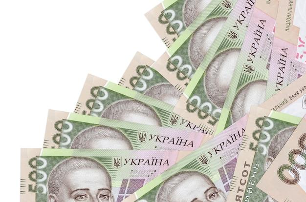 500ウクライナグリブナの請求書は白で隔離された異なる順序であります。ローカルバンキングまたは金儲けの概念。