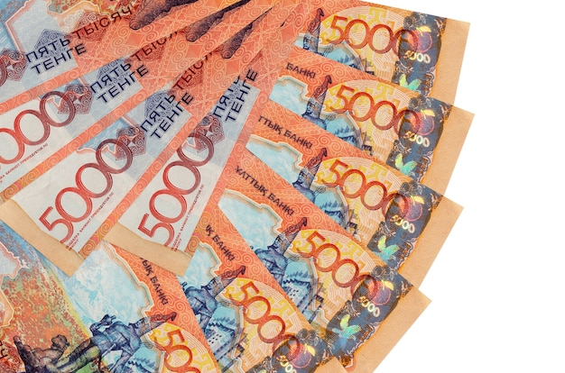 5000 kazakhstani tenge bills lies isolated on white background with copy space stacked in fan shape close up
