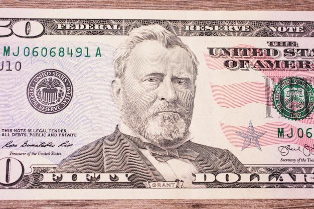 Предпосылка денег, лицевая сторона 50 долларовых банкнот. фон долларов, крупный план, портрет государственного деятеля сша, изобретателя и дипломата улисса с.