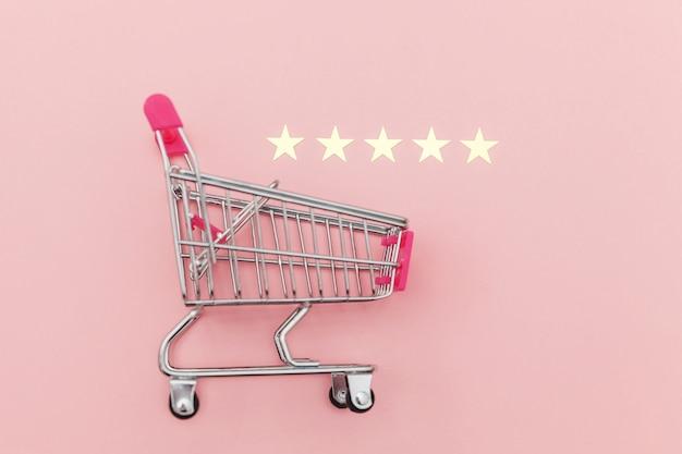 車輪と5つ星評価のショッピンググッズの小さなスーパーマーケットの食料品プッシュカート