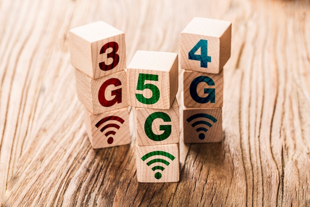 5g (5th generation) network connecting technology future global hand flip wood cube change number 4g to 5g