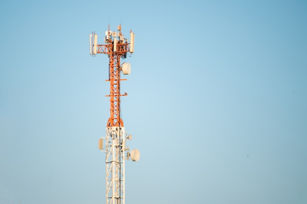 5g modern tv and smartphone telecommunication station antenna against the sky in the city