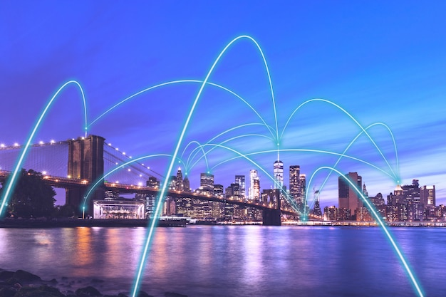 5g smart city communication network concept in new york - downtown manhattan night view with abstract links connecting buildings, wireless, visualisation of the internet of things