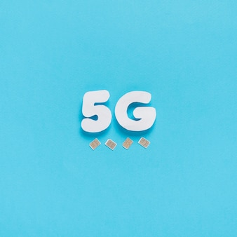 5g spelled out on plain background with sim cards
