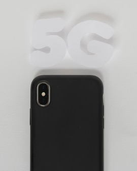 5g text above mobile phone