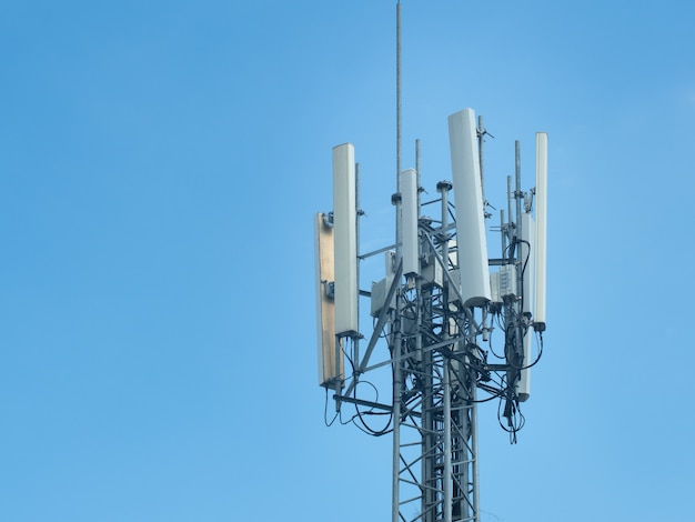 5g tower of cellular communication or telecommunication tower on blue sky.