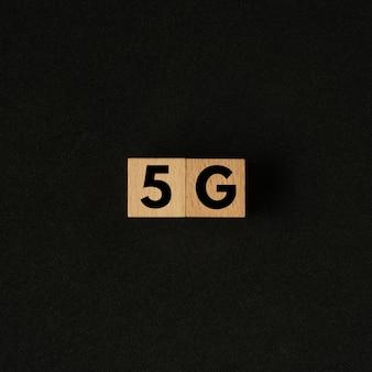 5g word on wooden block.