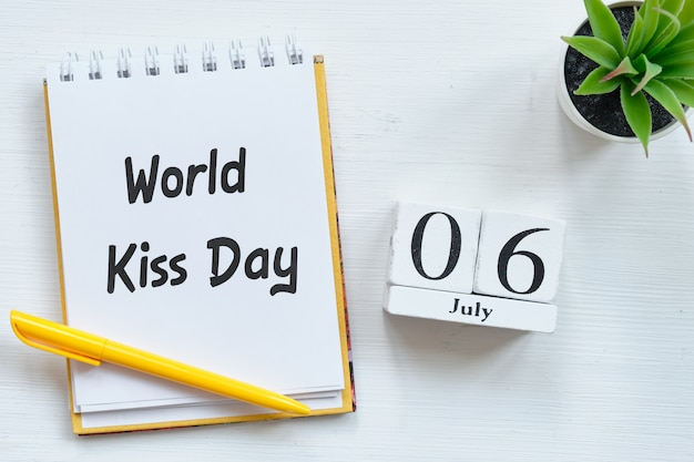 6th july world kiss day sixth of month calendar concept on wooden blocks.