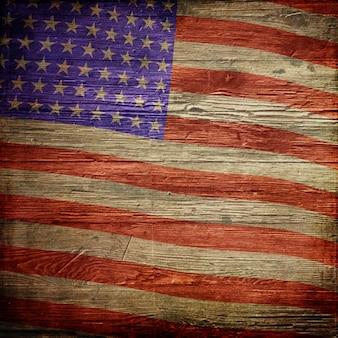 グランジウッドテクスチャにアメリカの国旗と7月4日の独立記念日の背景