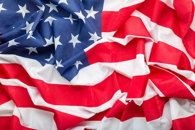 アメリカの旗の背景。米国の記念日または7月4日。クローズアップテクスチャアメリカ合衆国または米国の旗の旗。