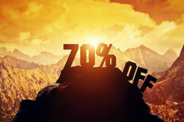 70% off writing on a mountain peak.
