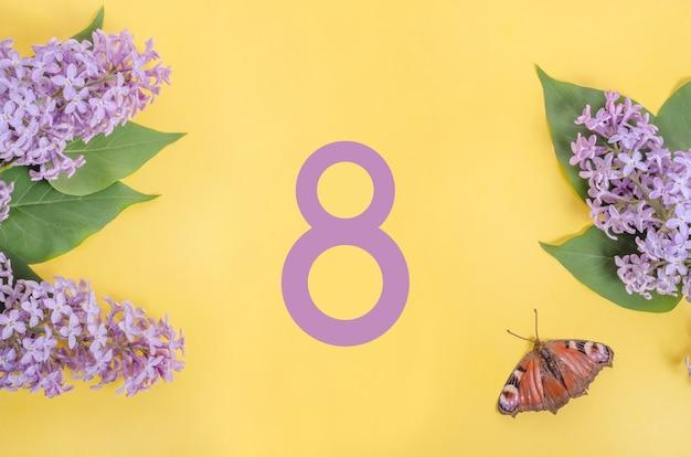 8 марта из цветов на желтой стене, международный женский день