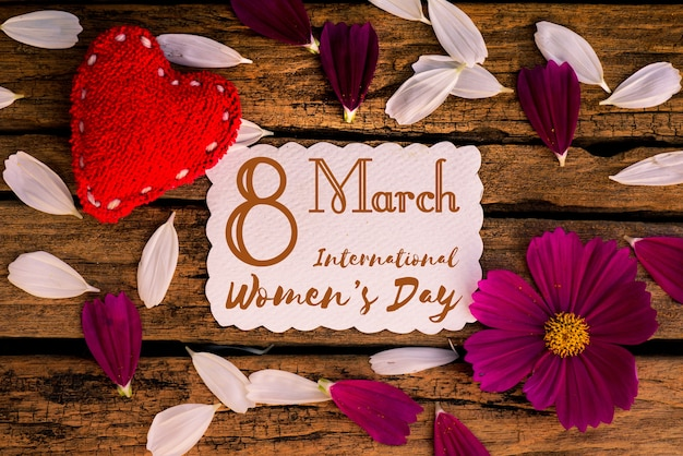 8 march happy international women's day message on wooden background.