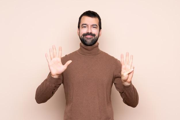 指で8を数える男