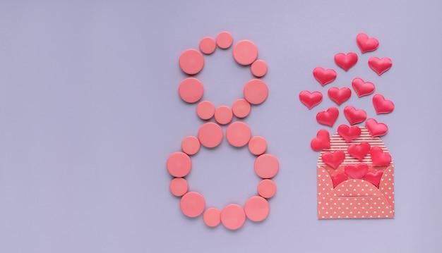 8 марта, международный женский день. восьмерка розовых пуговиц, конверт с сердечками.