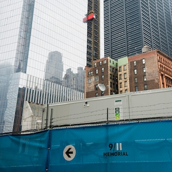 9/11 memorial sign in front of modern skyscrapers, lower manhattan, new york city, new york state, u