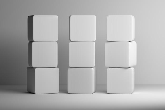 丸みを帯びたエッジを持つ9つの白い立方体のセットは互いに積み重ねられています。 3 dイラスト